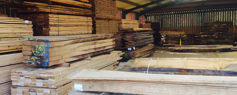 Oak beam stack in warehouse